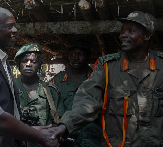 Okot George Odek (far left) with Kony (far right) and deceased LRA commander Okot Odhiambo (center) at failed Juba peace talks in 2008. Photo credit: Unknown.