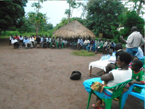 Agnes (foreground), at the welcome ceremony for the two children belonging to an LRA commander who were released from captivity with her.
