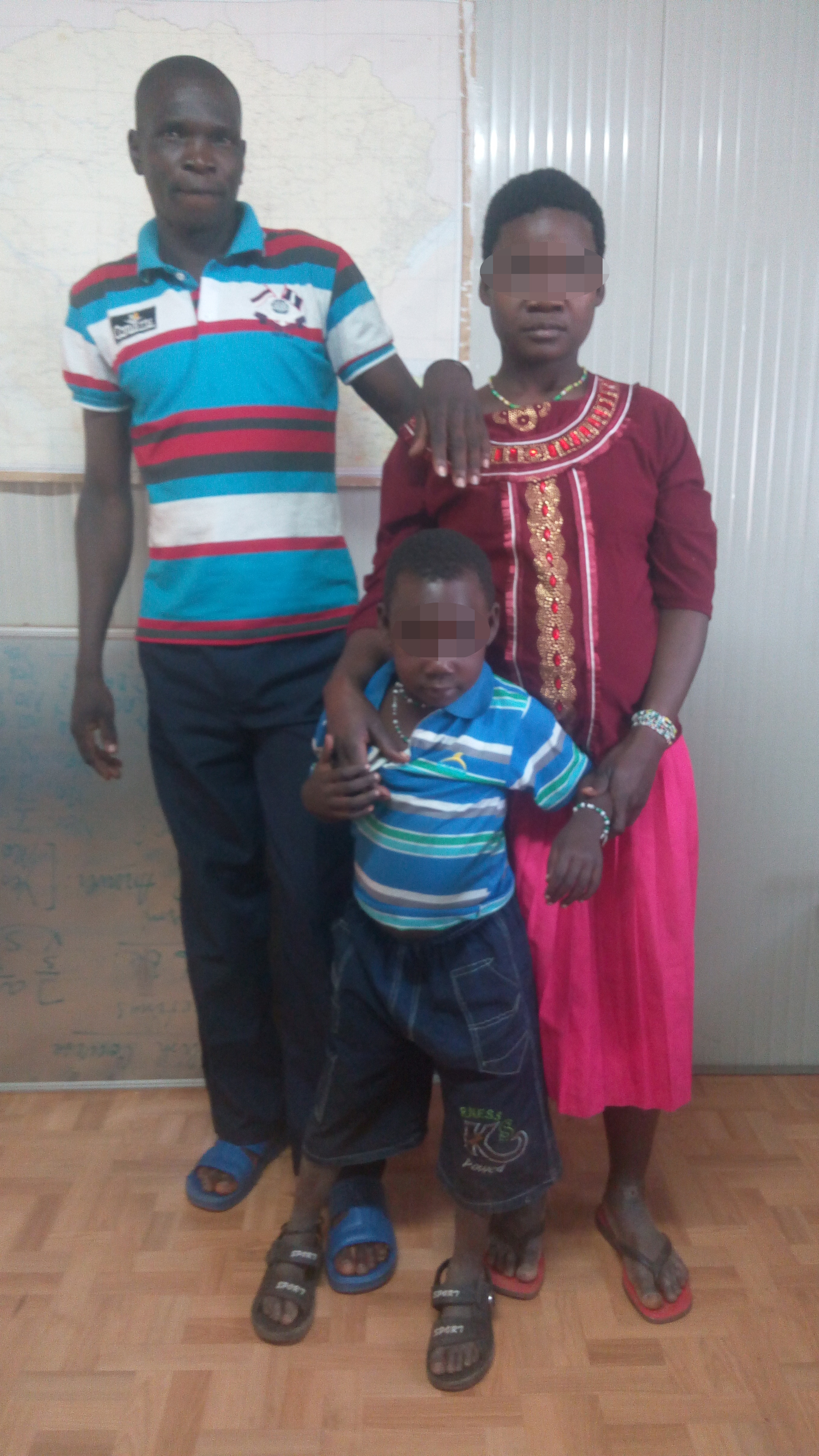 Bosco with the woman and child he escaped LRA captivity with.